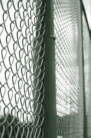 barbed wire and fence: Metallic fence. Stock Photo