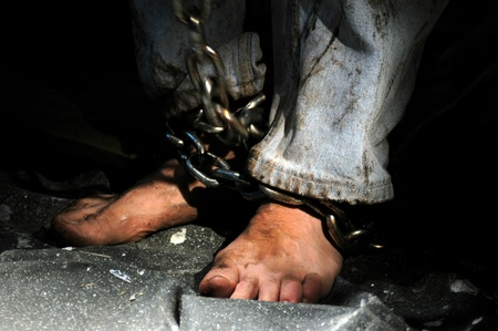 slavery: Chained person.