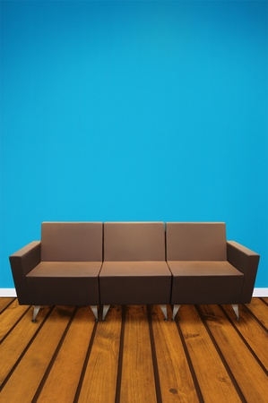 Couch against blue wall. Stock Photo
