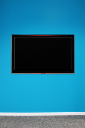 Wide Tv on wall. Stock Photo - 9674860