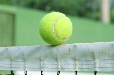 Tennis ball on net photo