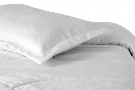 duvet: Bed against white background  Stock Photo