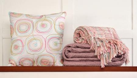 unattended: Bedding objects on shelf