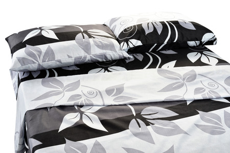 pattern bed: Bed covered with bed spreads and soft pillow. Stock Photo