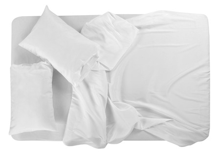 Bed covered with bed spreads and soft pillow. Banque d'images