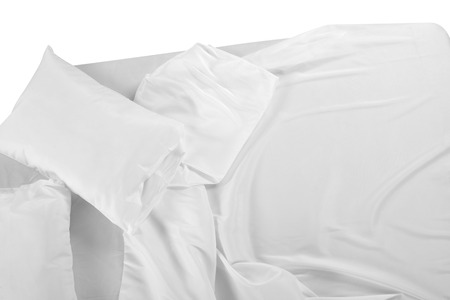 bed sheet: Bed covered with bed spreads and soft pillow. Stock Photo