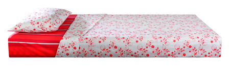 unattended: Bed covered with bed spreads and soft pillow. Stock Photo