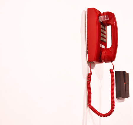 Emergency phone hanging on a wall. photo
