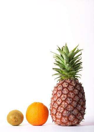Fresh pineapple, juicy orange and sweet kiwi Stock Photo - 5743925