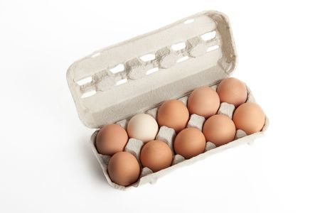 the hen's eggs in pack on white background Stock Photo - 5743922