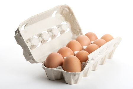 hen's: the hens eggs in pack on white background Stock Photo