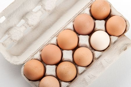 the hen's eggs in pack on white background Stock Photo - 5743930