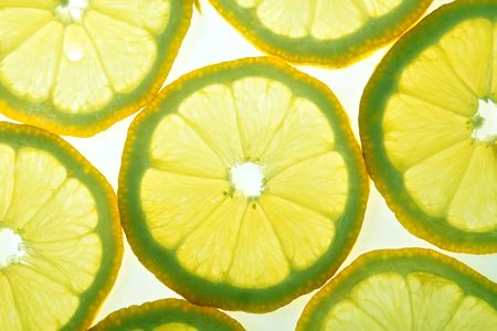 A lot of yellow lemon slices on white background Stock Photo - 5751252