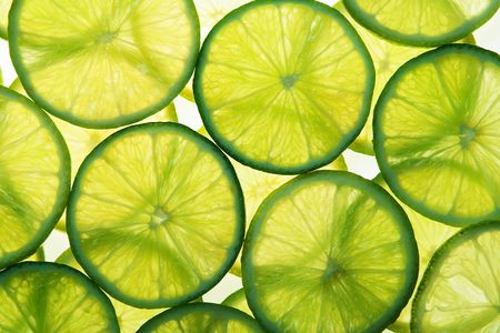 Green lime slices in many layers on white background Stock Photo