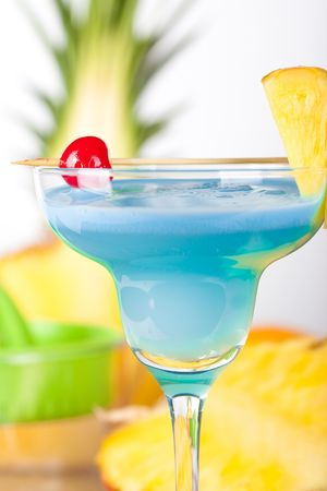 vermouth: Blue alcohol cocktail with pineapple, orange and cherry