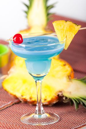 Blue alcohol cocktail with pineapple, orange and cherry Stock Photo - 5809407