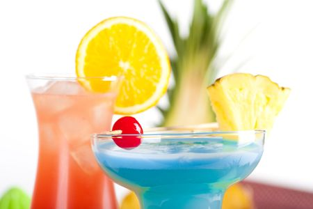 Two tropical cocktails with pineapple, orange and cherry Stock Photo - 5838171