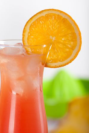 Red cocktail with ice and orange slice Stock Photo - 5838152