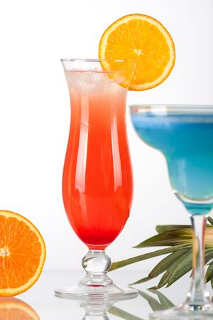 Two tropical cocktails with pineapple, orange and cherry Stock Photo - 5838140
