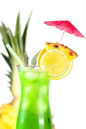 Green tropical cocktail with pineapple, orange and lime slices on white background Stock Photo - 5838162