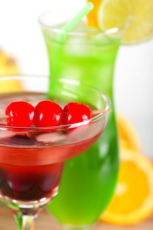 Green and red tropical cocktails with pineapple and cherry Stock Photo - 5838158