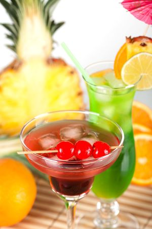 Green and red tropical cocktails with pineapple and cherry Stock Photo - 5838166