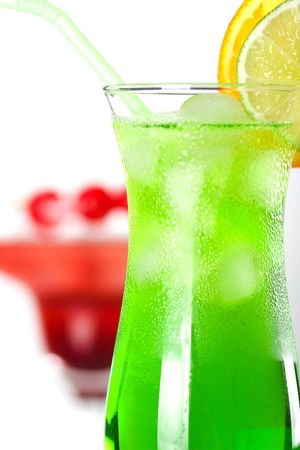Green and red tropical cocktails with pineapple and cherry Stock Photo - 5838145