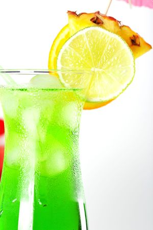 Green and red tropical cocktails with pineapple and cherry Stock Photo - 5838168