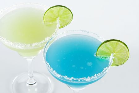Classic margarita and blue margarita alcohol cocktails (top view) isolated on white background Stock Photo