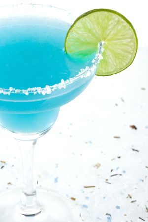 tequila: Blue margarita cocktail with lime slice