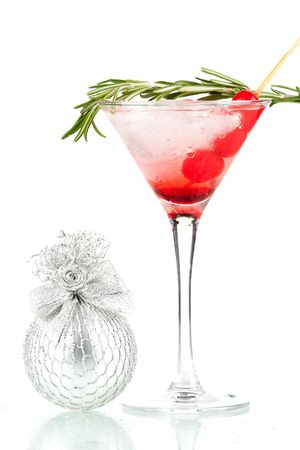 Christmas martini cocktail with maraschino and rosemary isolated on white background
