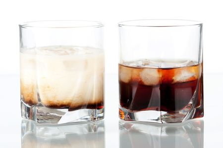 Black russian and white russian cocktails. Ingredients for black: 5 oz vodka, 2 oz kahlua. Ingredients for white: 2 oz vodka, 1 oz kahlua, 1 oz milk Stock Photo