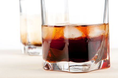 Black russian and white russian cocktails. Ingredients for black: 5 oz vodka, 2 oz kahlua. Ingredients for white: 2 oz vodka, 1 oz kahlua, 1 oz milk Stock Photo - 5934654