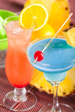 Two tropical cocktails with pineapple, orange and cherry Stock Photo - 5956042