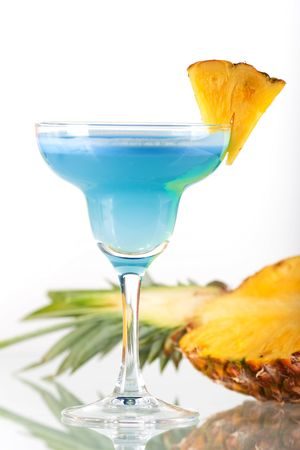 Blue alcohol cocktail with pineapple slice Stock Photo - 6034379