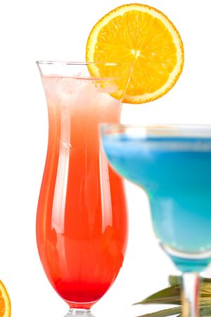 Two tropical cocktails with pineapple, orange and cherry Stock Photo - 6034384