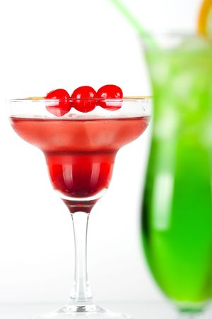 Green and red tropical cocktails with pineapple and cherry Stock Photo - 6034383