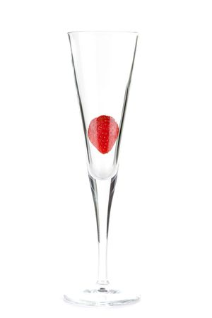 Strawberry in champagne glass isolated on white background photo