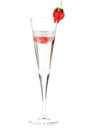 Champagne with strawberry - christmas alcohol cocktail. Isolated on white background photo