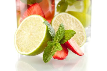 Lime, strawberry and mint isolated on white background Stock Photo - 6111091