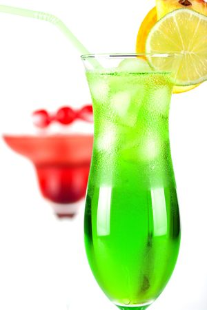 Green and red tropical cocktails with pineapple and cherry Stock Photo - 6123568