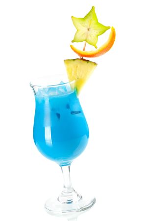 Blue Hawaii tropical cocktail with pineapple and carambola isolated on white background photo