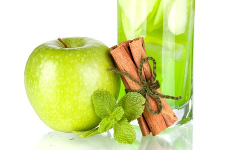 Green cocktail with apples, mint and cinnamon isolated on white background photo