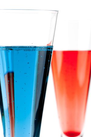 Red and Blue Champagne alcohol cocktail isolated on white background. Ingredients: 1 oz grenadine (or blue curacao) and 10 oz champagne Stock Photo - 6199995