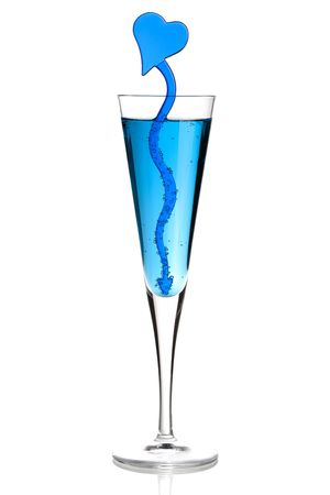 Blue champagne alcohol cocktail with heart decoration. Isolated on white background photo