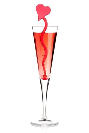 Red champagne alcohol cocktail with heart decoration. Isolated on white background photo