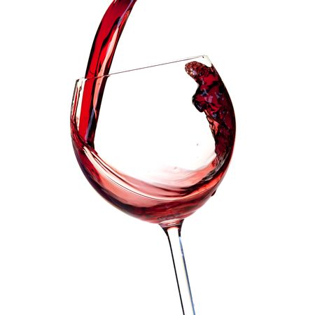 pour: Wine collection - Red wine is poured into a glass. Close up. Isolated on white background