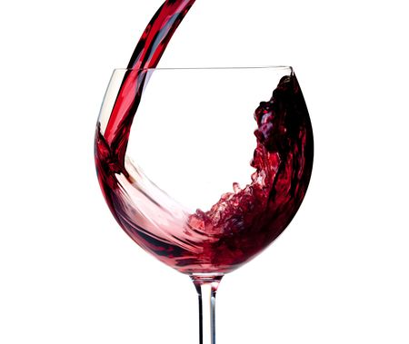 drinkable: Wine collection - Red wine is poured into a glass. Closeup. Isolated on white background