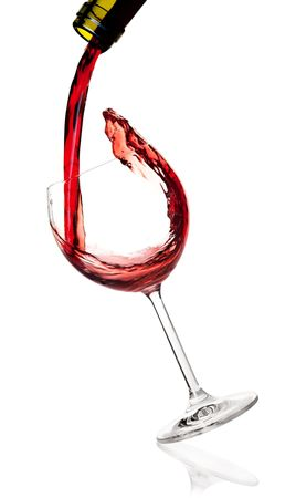 Wine collection -  Red wine is poured into a falling glass. Isolated on white background photo