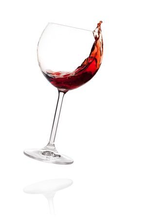 Wine collection - Red wine in falling glass. Isolated on white background photo